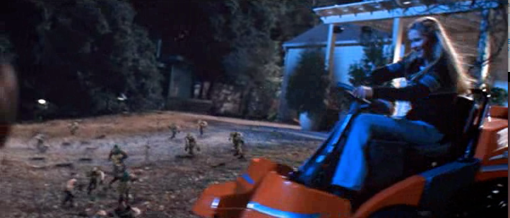 Kirsten Dunst riding a Husqvarna lawn mower in the movie Small