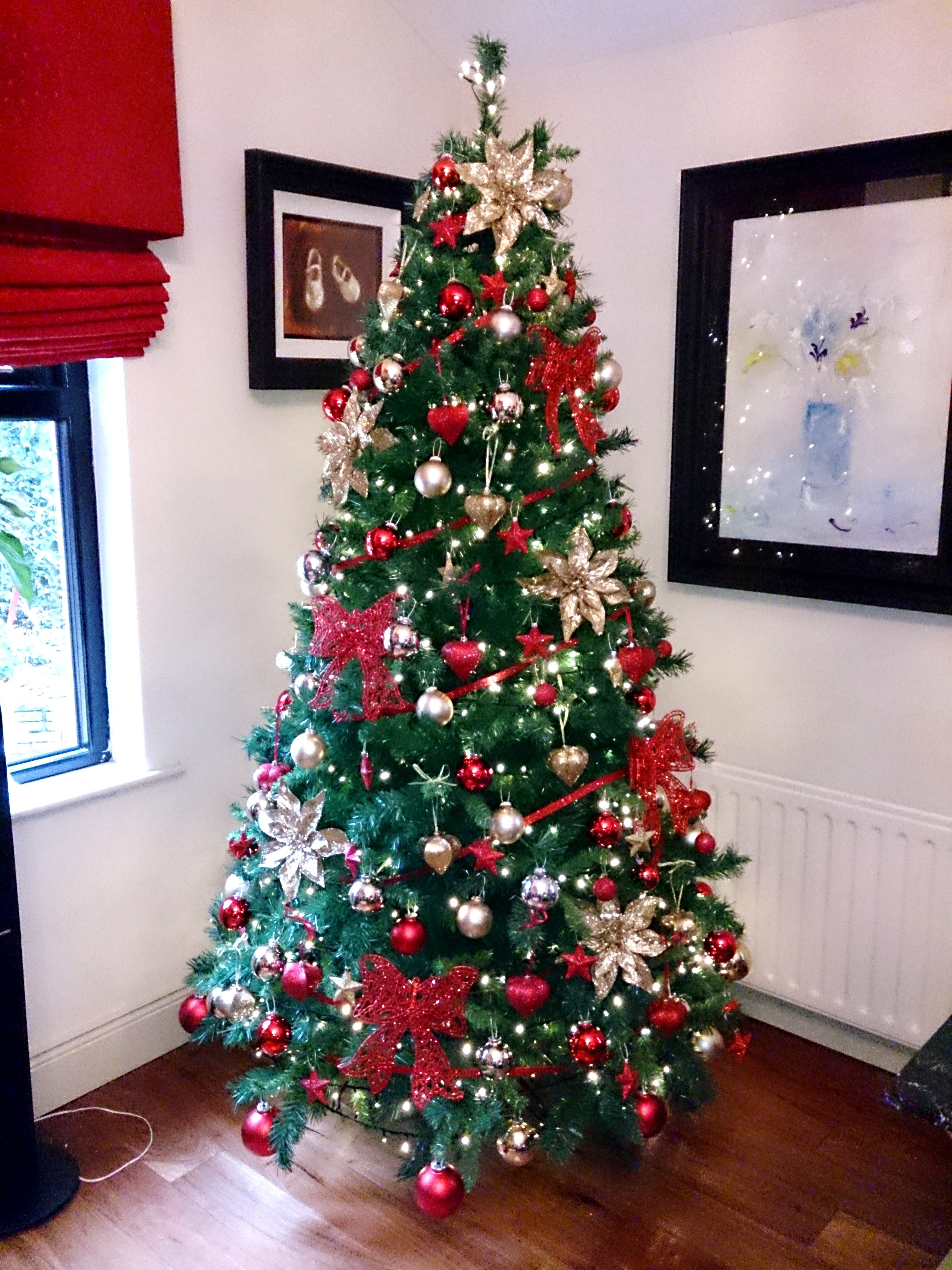 A stunning 7ft artificial tree filled with our luxury decorations, glitter bows, glitter ...