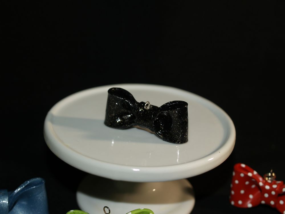 """Black bow with gold specks. 1 3/4""""."""