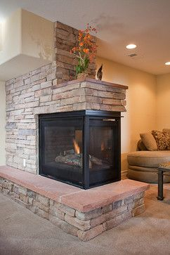 A peninsula fireplace adds warmth and interest to multiple living a peninsula fireplace adds warmth and interest to multiple living spaces designed and finished by highcraft teraionfo