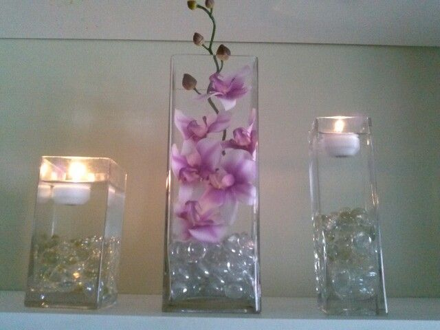 Orchids,clear rocks,and floating candels