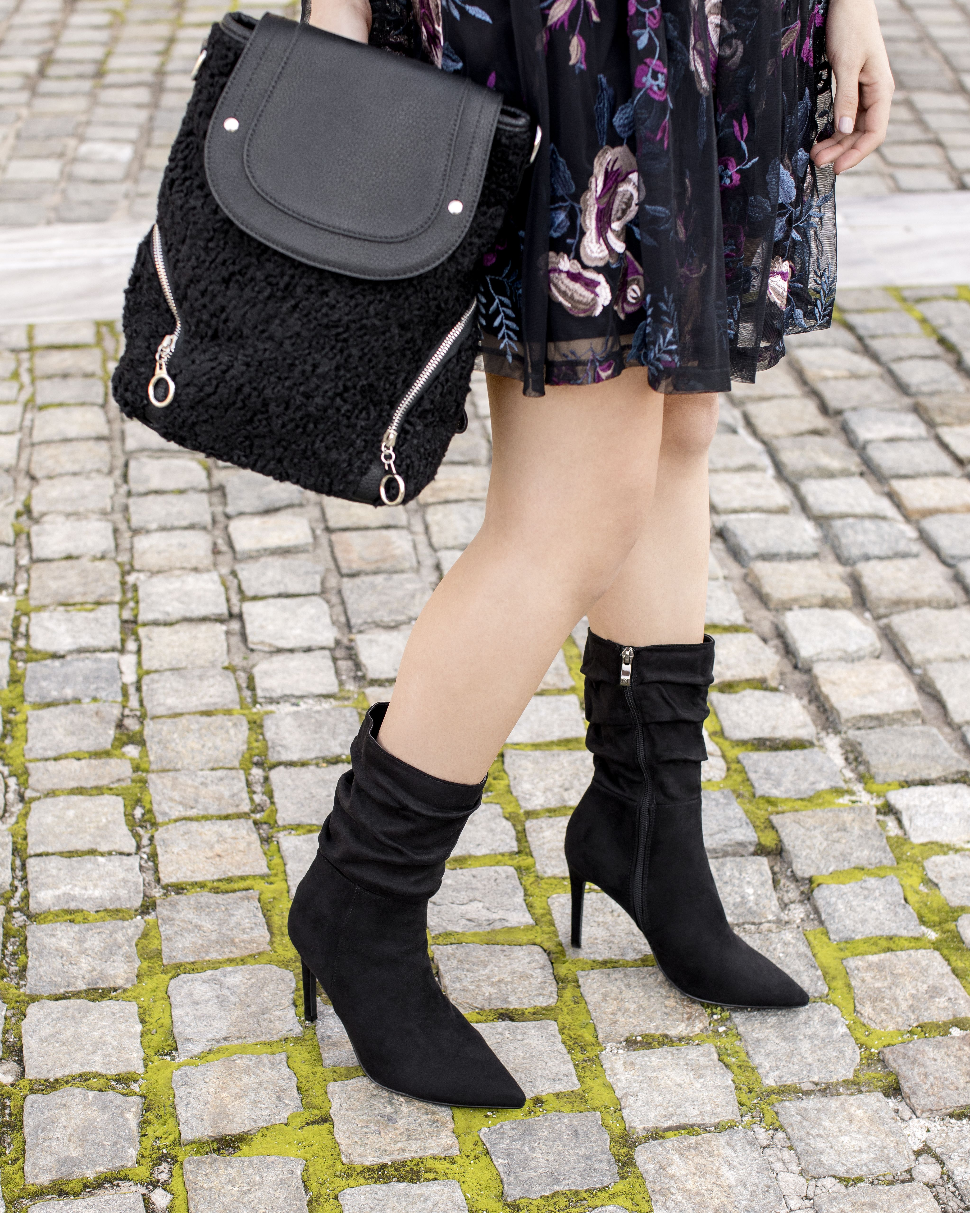 cbcdd017ac2 Strolling around the city in the stylish #MIGATO ES2025 black high heel  booties and EF23 black backpack! Shop online the booties ▻  bit.ly/ES2025-L14 and ...