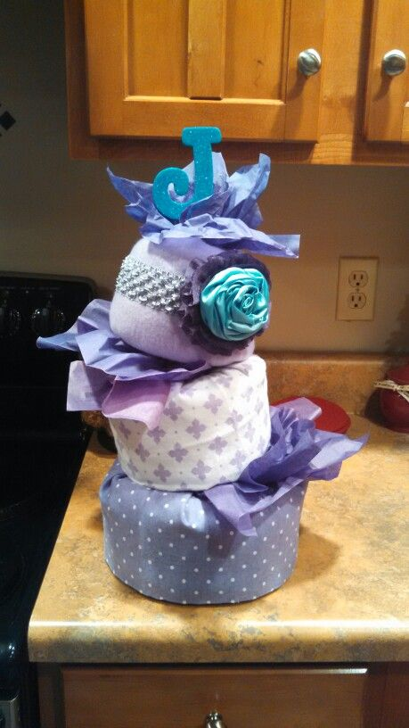 How Kristen #2shower turned out. Its a girl. Sea theme. Purple teal. Topsy turvy diaper cake.