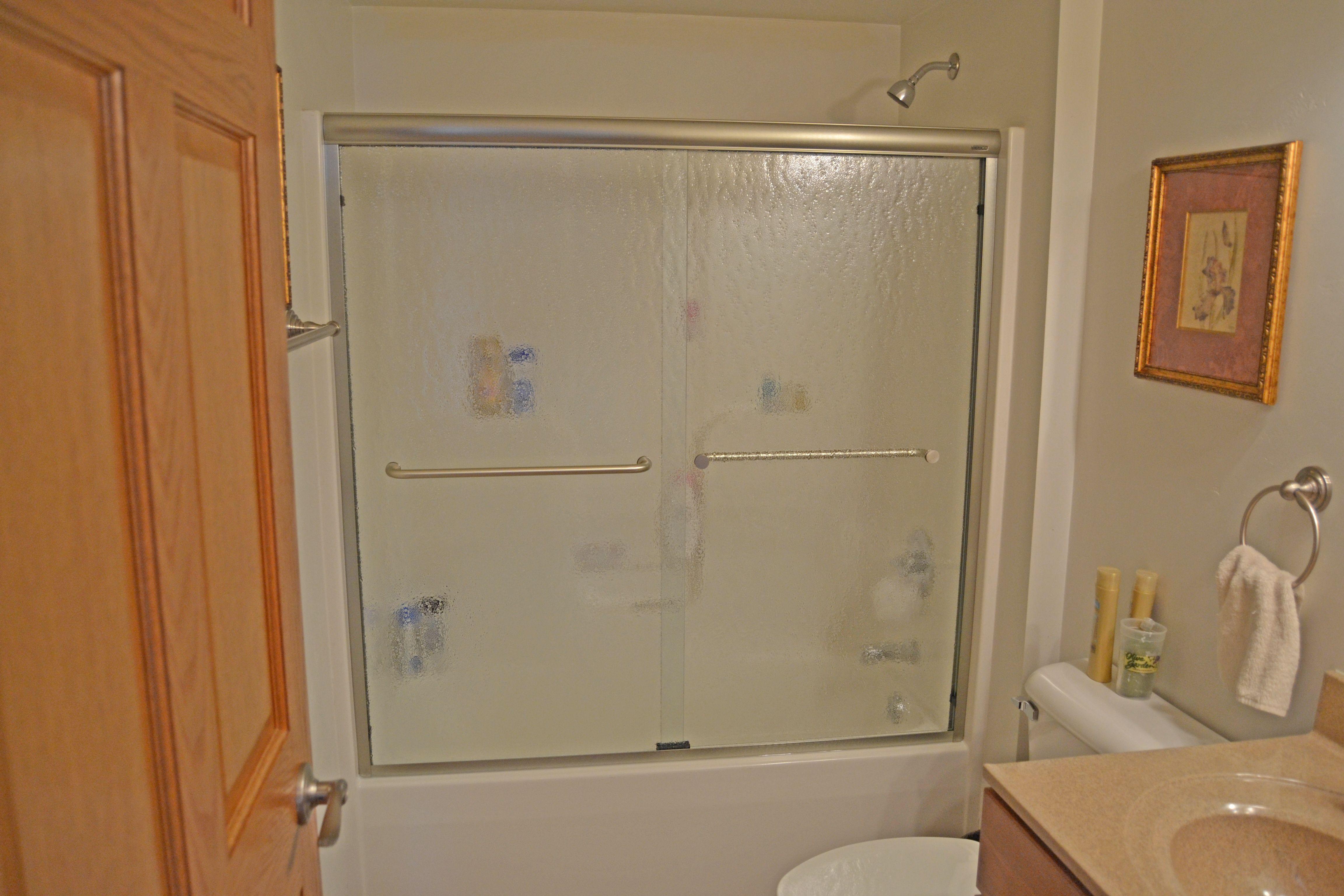 Basco Frameless Sliding Shower Doors On A Tub With Vessence Glass