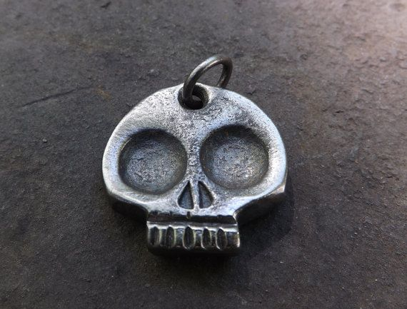 one of a kind and unique hand forged skull keychain it is