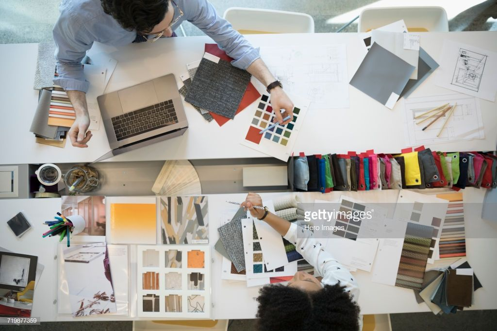 Overhead View Designers With Fabric Swatches In Conference Room Interior Design Principles How To Become An Interior Designer Western Style Interior