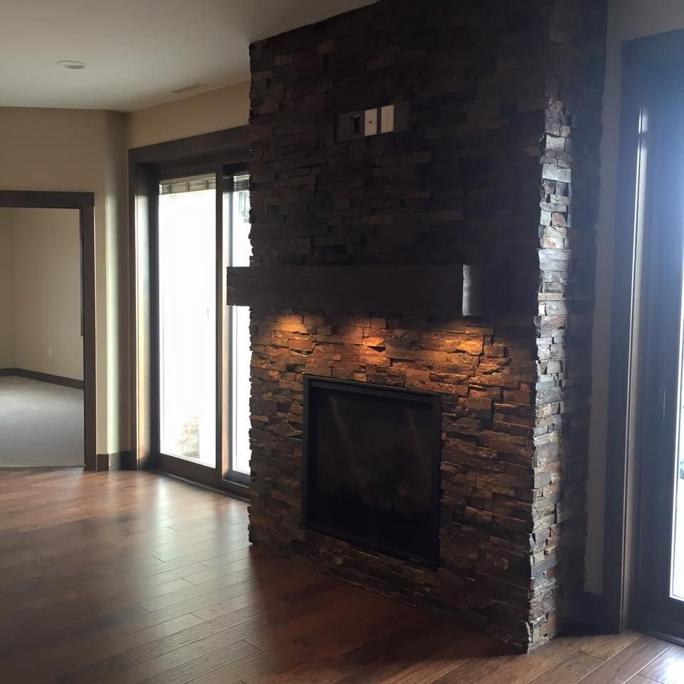 Lights Under The Mantel Of The Brick Fireplace (Soul Interiors, Bismarck, ND )