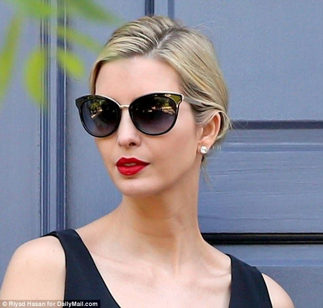 7d95f6c530a The first daughter donned a bold red lip and cat-eye sunglasses to shield  he.