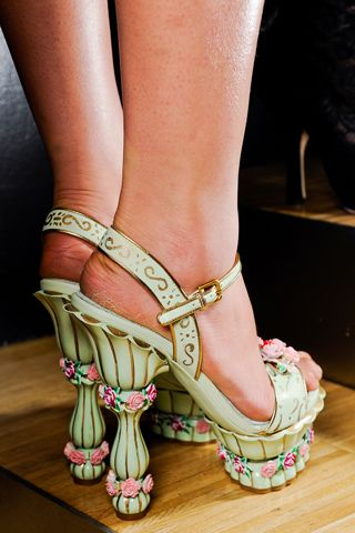 Dolce  Gabbana - they look beautiful,  but all women wearing very high heels make me laugh - mostly when walking in them.....