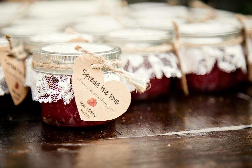 Homemade strawberry jam as favors for brunch wedding.