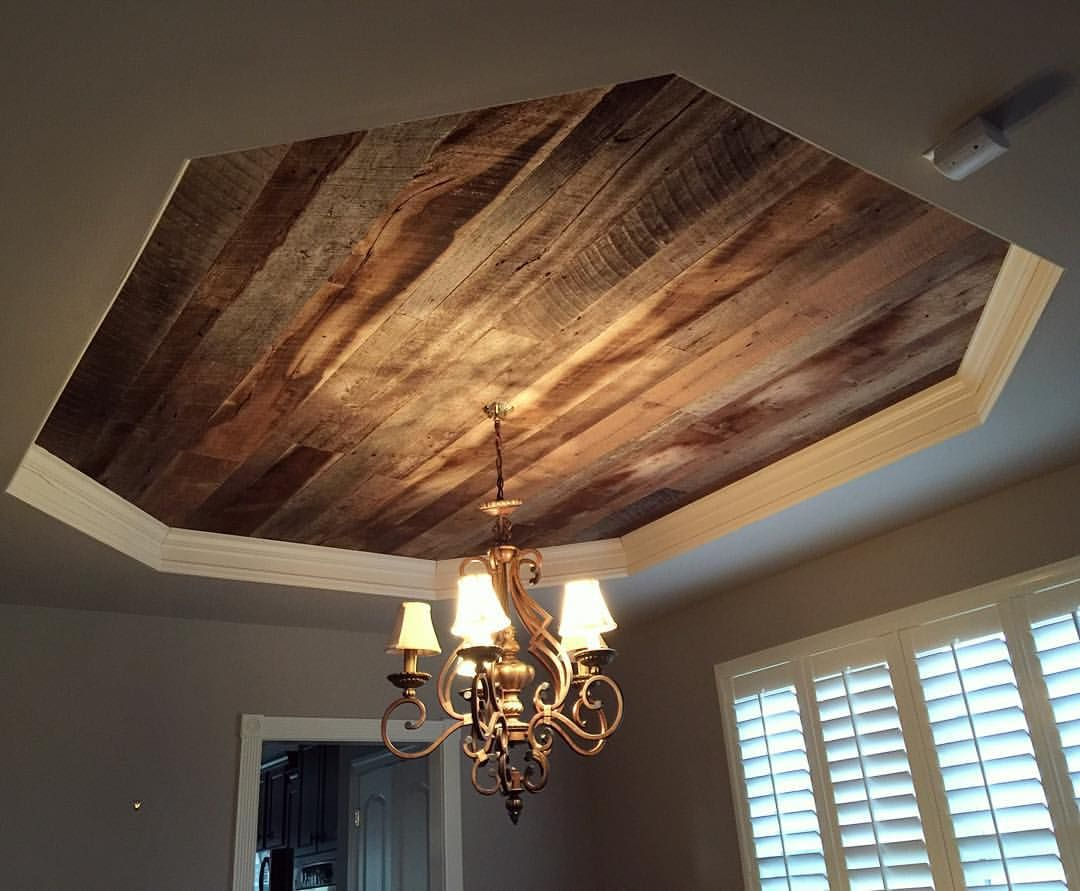 We installed our barn wood skins on this dining room tray Shiplap tray ceiling