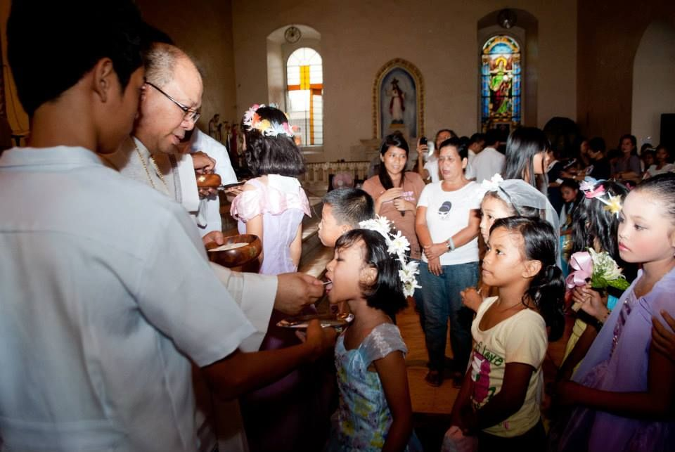 First Communicants. Innocently receiving the body and blood of Christ.