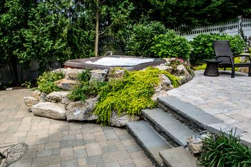 Natural Rocks Around Portable Jacuzzi Long Island Hot Tub Hot Tub And Pool Experts Pools And Spas Hot Tub Landscaping Hot Tub Outdoor Hot Tub Backyard