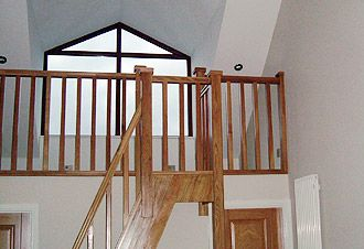 Mezzanine Loft Conversion albar construction – master bedroom with mezzanine floor above en