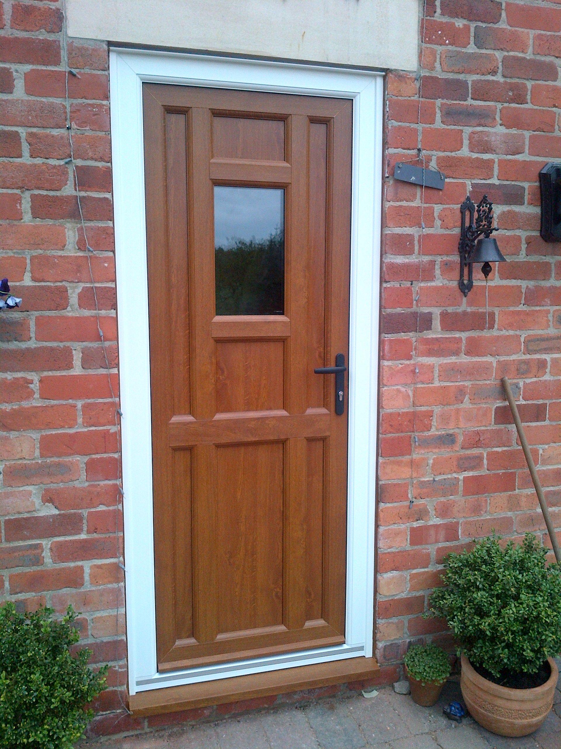Fenesta upvc doors windows glass flooring - Bespoke Upvc Front Door In Light Oak With Black Door Furniture Https Upvcfabricatorsindelhi
