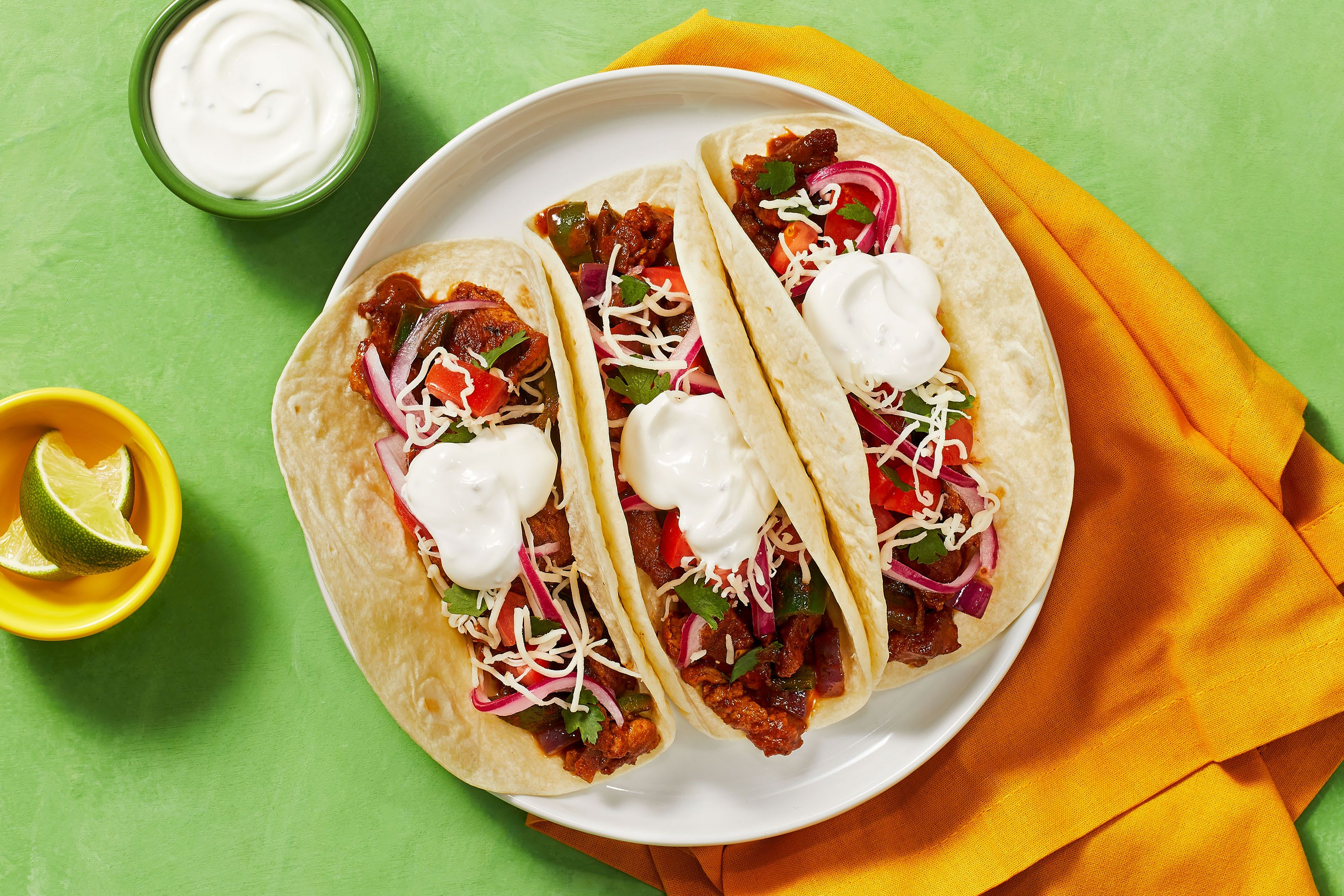 Diced pork carnitas tacos with pickled onion and monterey