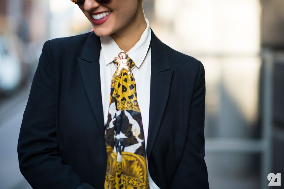 Scarf tied as tie with brooch. It's all about how you wear it.
