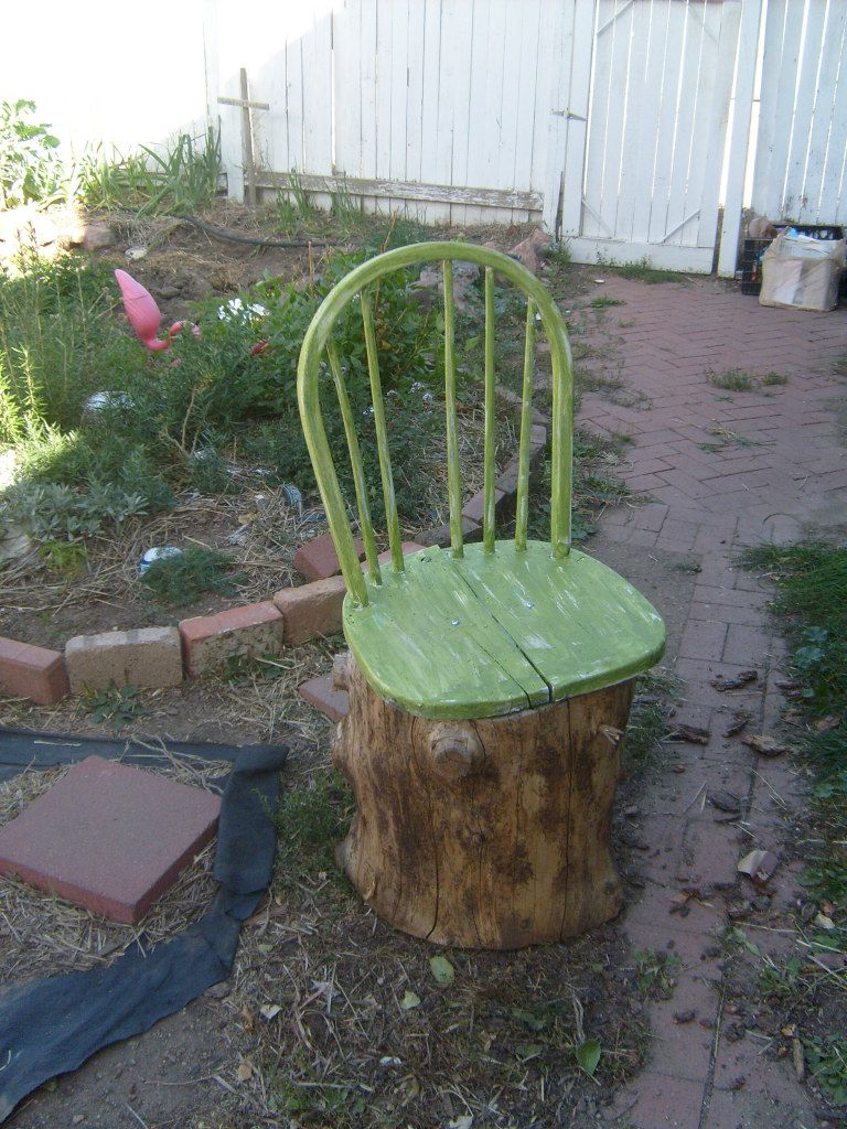 upcycle a stump and an old chair and you get a garden chair