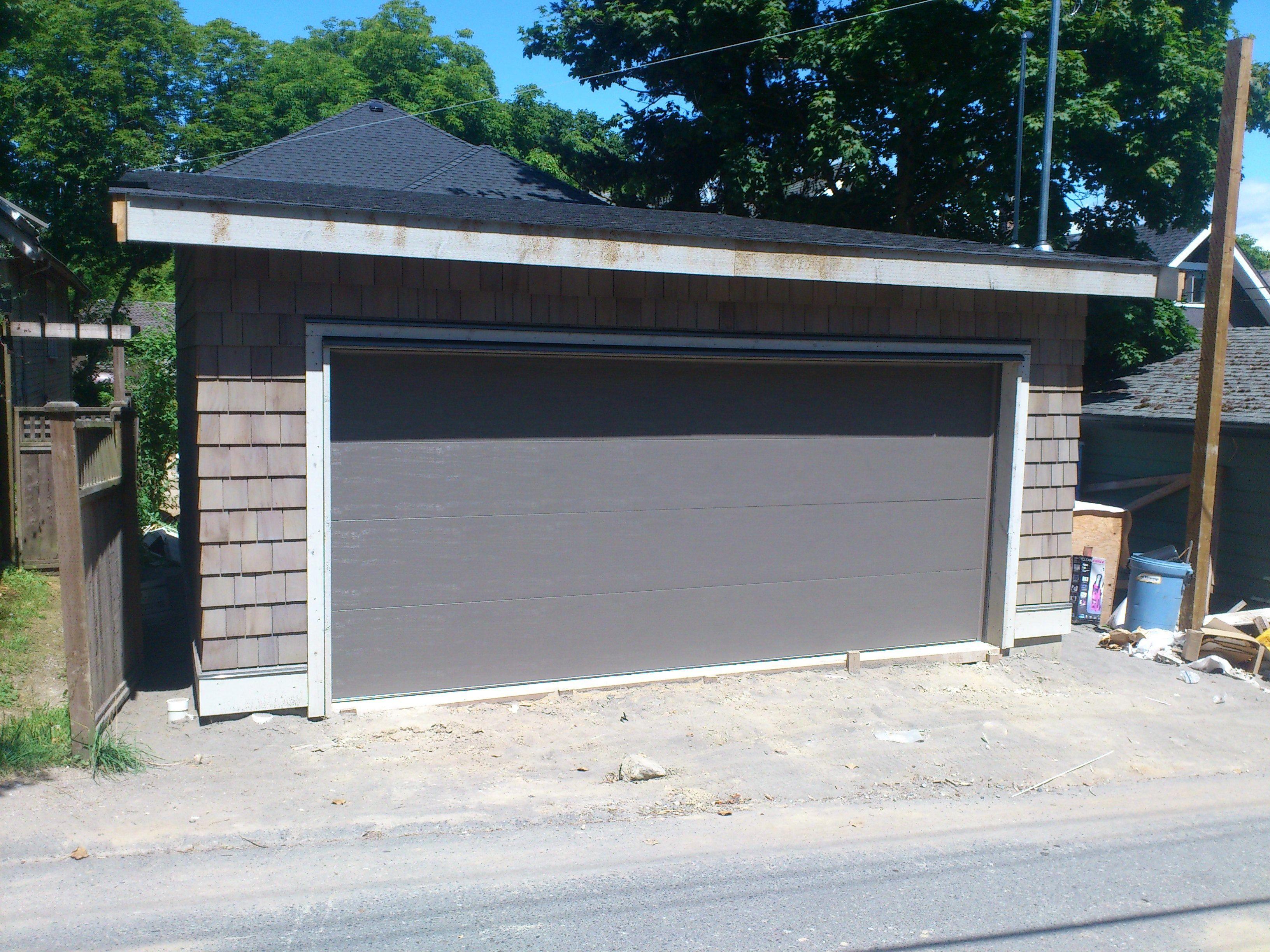 Clopay Classic Series Premium Insulated 1 3 8 Garage Door In Bronze Bronze Is The New Sandtone Of Garage Doors Garage Doors Doors Garage