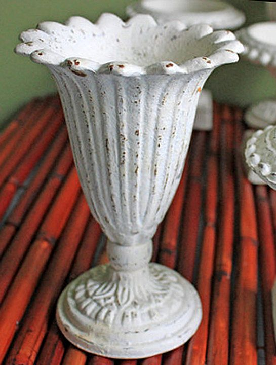 vintage cast iron vase. footed vase with scalloped rim painted