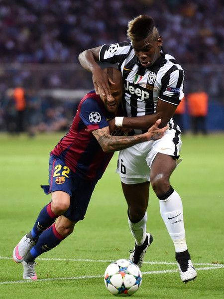 Daniel Alves of Barcelona challenges for the ball with Paul Pogba of Juventus during the UEFA Champions League Final between Juventus and FC Barcelona at Olympiastadion on June 6, 2015 in Berlin, Germany.