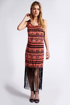 A unique piece from the Boutique collection, this dress has tassels extending into a maxi length, and a sequined Aztec design in vibrant hues, making it the perfect choice for summer! #aztecprint #summer #festival #whattowear #tassels #maxidress #shopping
