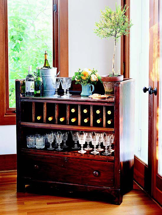 Storage Bar  Reconsider beat-up flea market finds like this old dresser. By removing a few drawers and restaining the piece, it was transformed into the perfect mini-bar