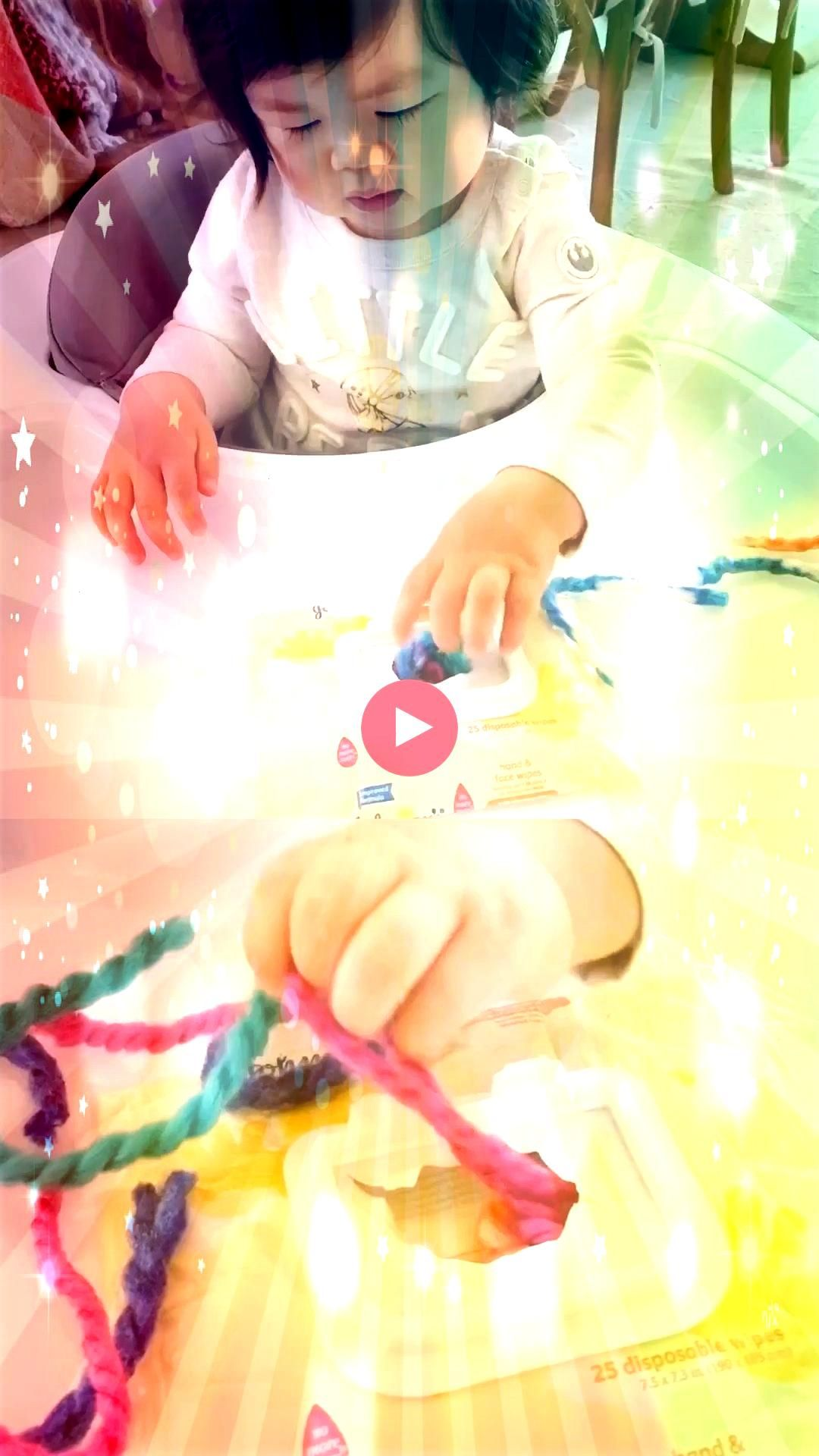 a baby wipe container to set up this easy yarn baby sensory fine motor skills activityRecycle a baby wipe container to set up this easy yarn baby sensory fine motor skill...