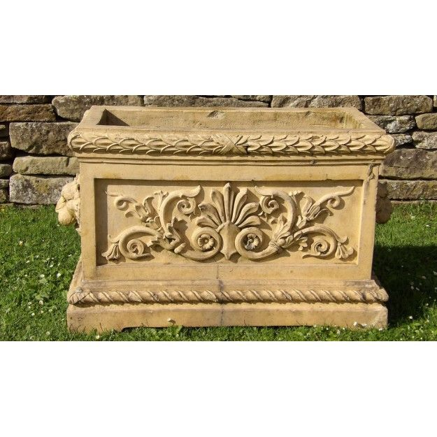 An antique terracotta planter rectangular in form with good internal depth and made from a high-fired yellow clay. The decoration is neoclassical in style with anthemion centred scrolling foliage on the sides and lion masks at each end. Although not apparently stamped, this planter was probably made by J Armitage and Son who established the Wharncliffe Fireclay Works at Deepcar near Sheffield in 1850 and produced some decorative goods as well as more utilitarian bricks and tiles throughout…