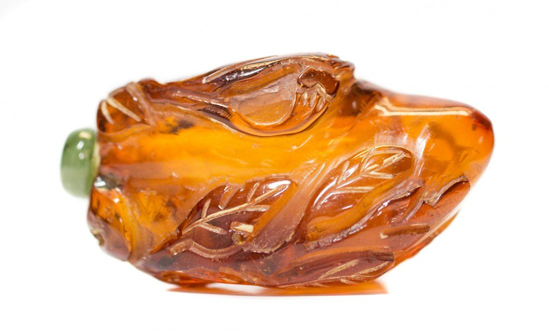 CHINESE CARVED AMBER SNUFF BOTTLE 19th Century. Of fruit/vegetable form, with a jade stopper.