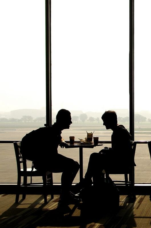 """""""Street scenes"""" from inside an airport terminal. The coffee shop."""