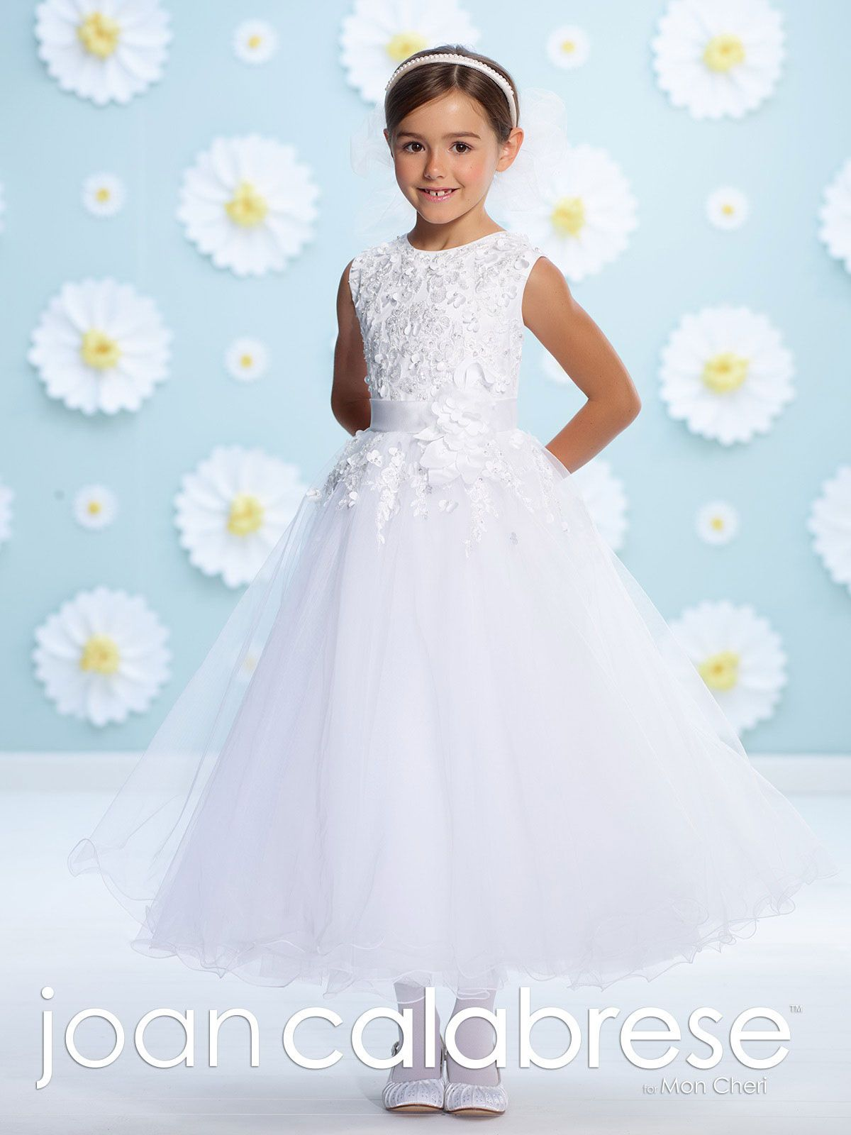 b30b361e2 This is truly a unique style for your one of a kind princess. The bodice  features a tulle overlay with beads and three dimensional flowers.