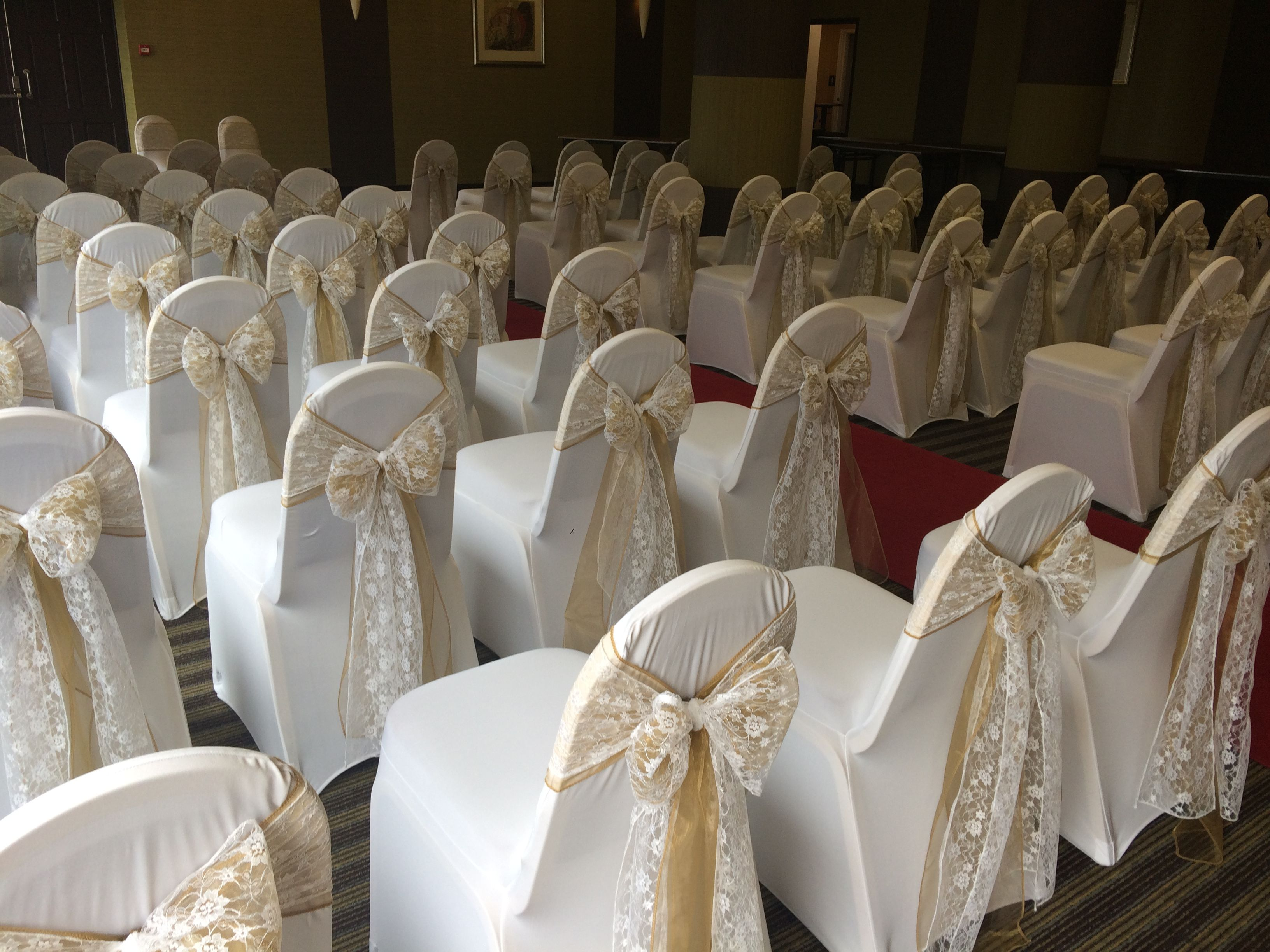 Wedding post box decorations  Chair covers with pale mocha organza and lace overlay at a Welsh