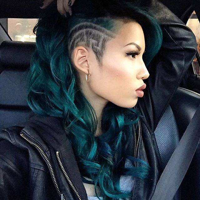undercut side shaved with teal hair