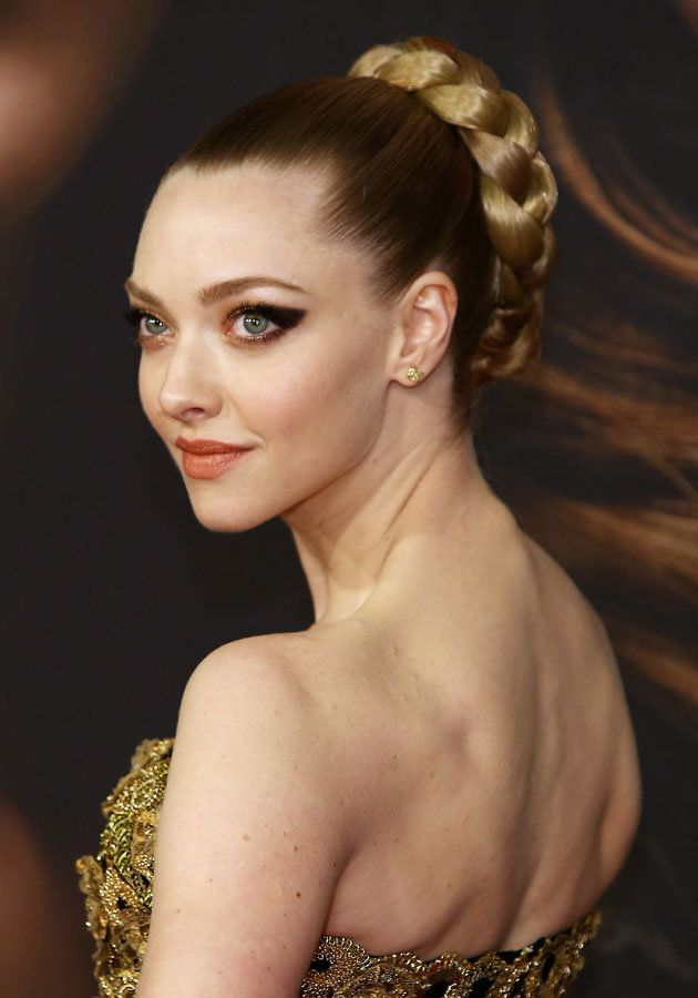 Amanda wore a smokey eye and chic up-do for the premiere © Rex