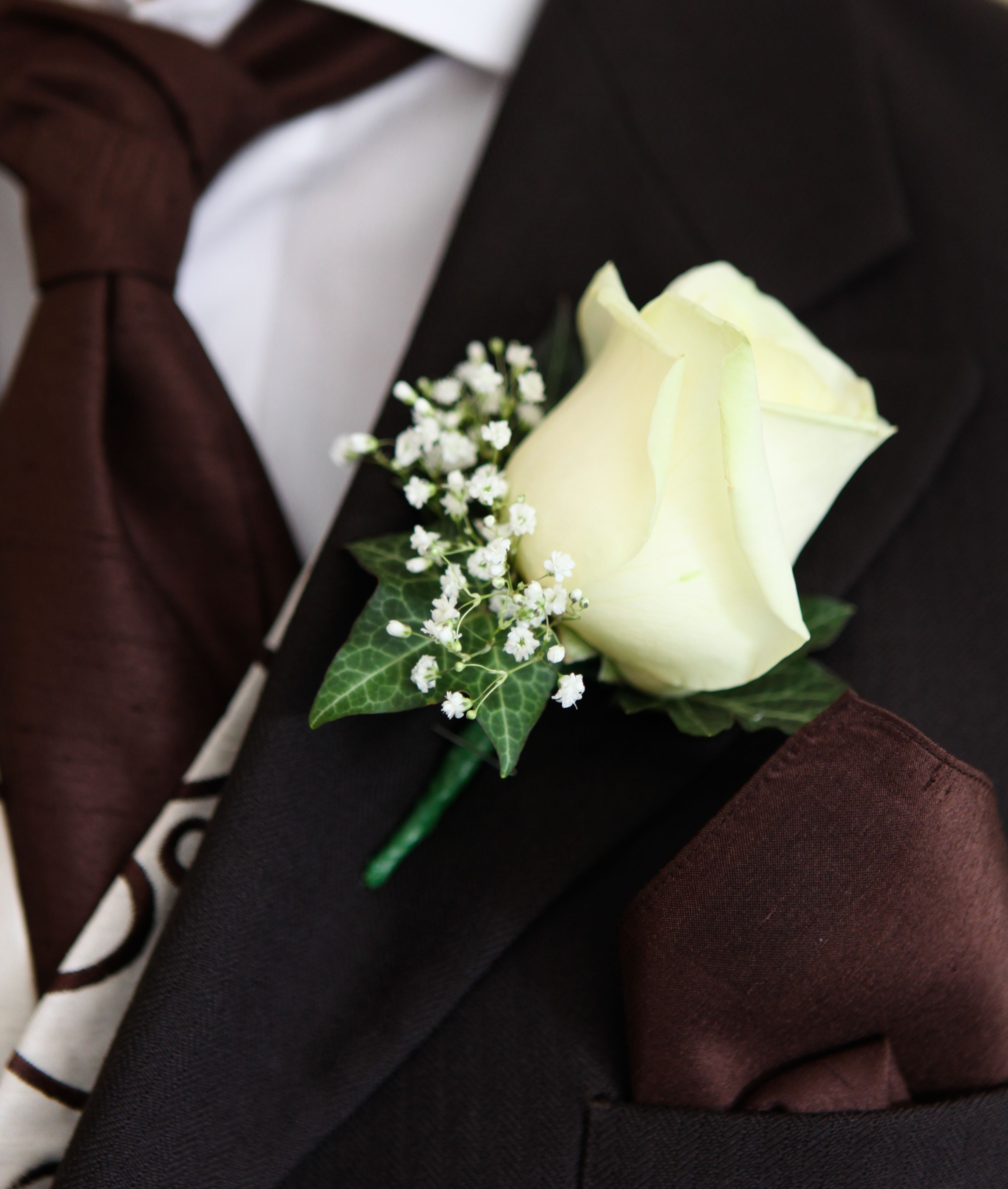 Rose Onhole For The Ushers With Ivy But Not Gypsophila