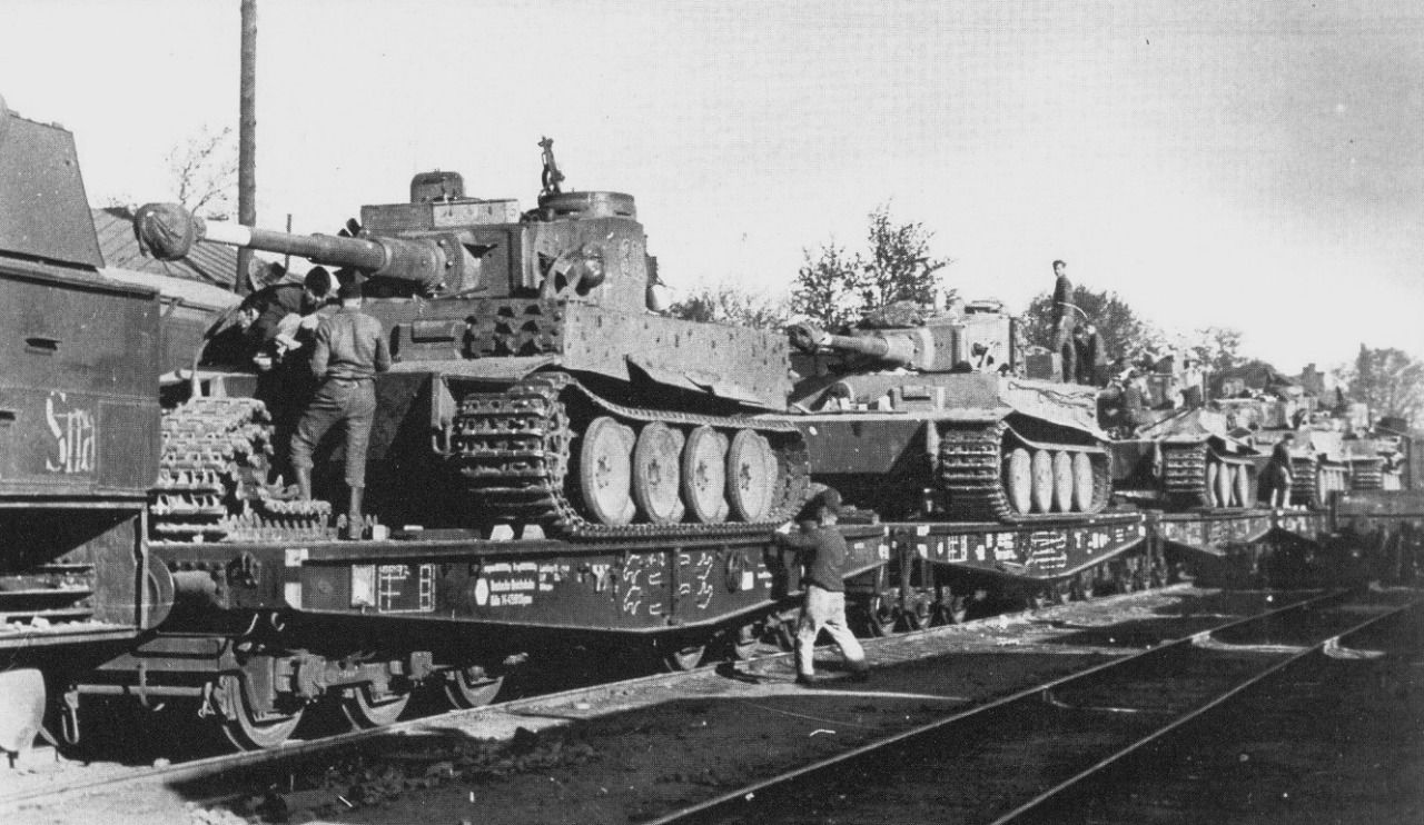 Brand new Tiger tanks being transported on rail cars on