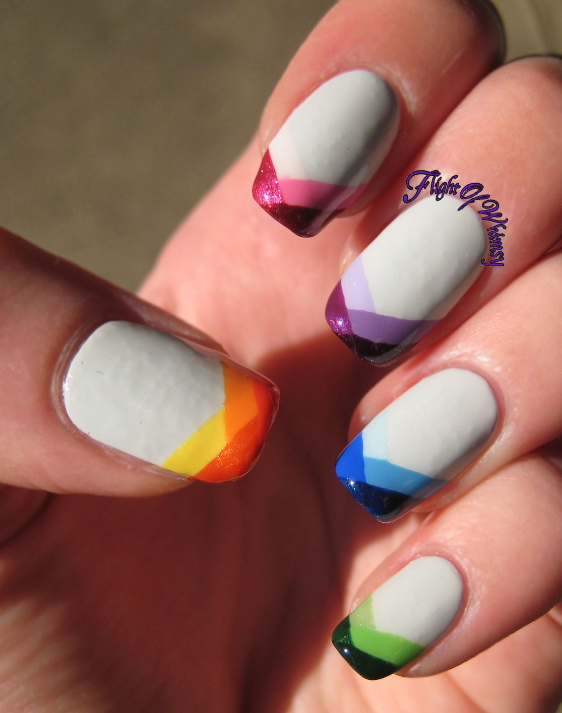 White nails with rainbow multi-color bright braided, fish tail tips ...