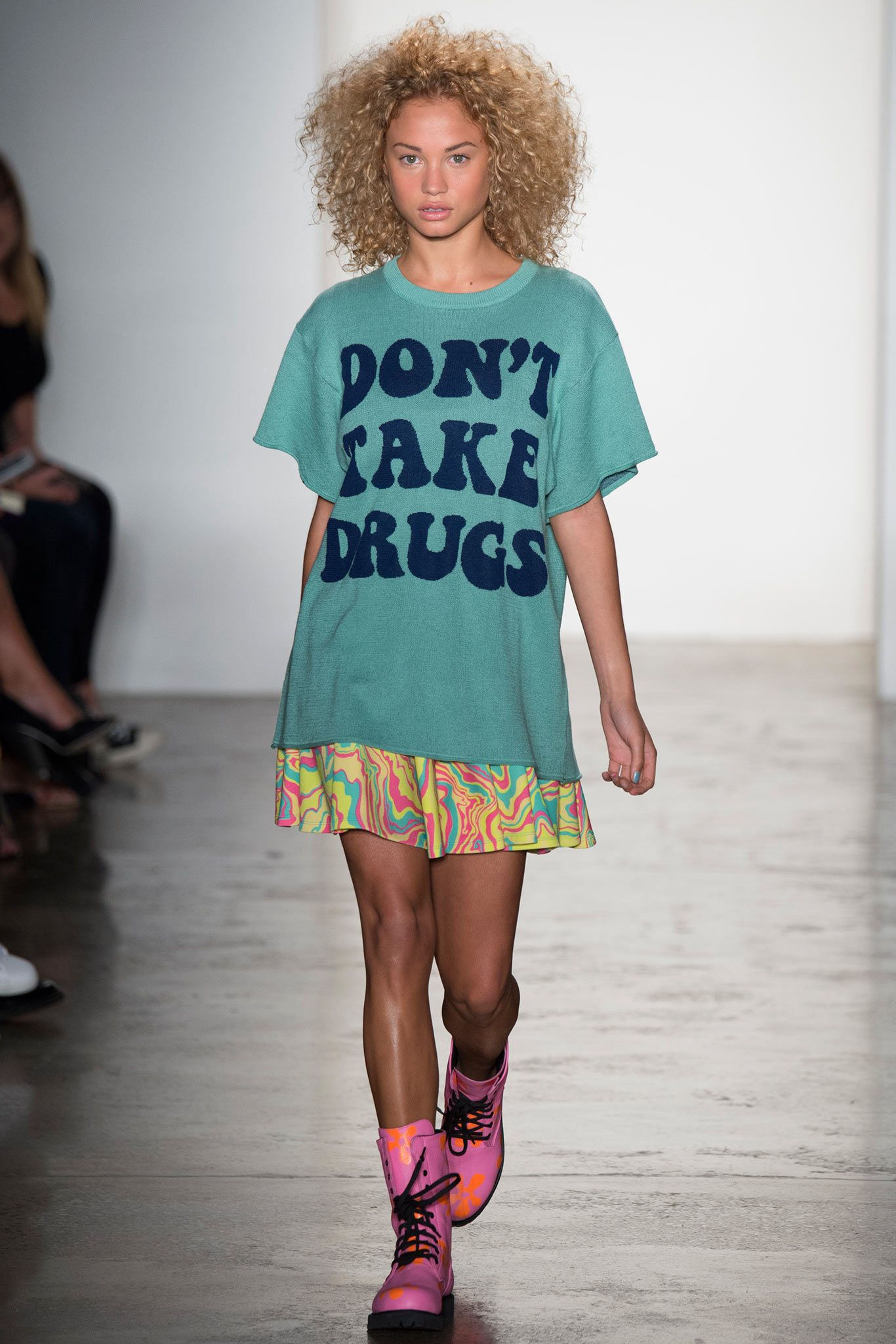 In this design by Jeremy Scott for Spring 2015 RTW, many features can be seen that are similar to ones that have been seen throughout the 90s. The iconic printed t-shirts began in the 90s, along with the oversized size of shirts, especially for women. Furthermore, the crazy hair along with the honky, bright boots all add to this 1990s effect. 4/7/2015