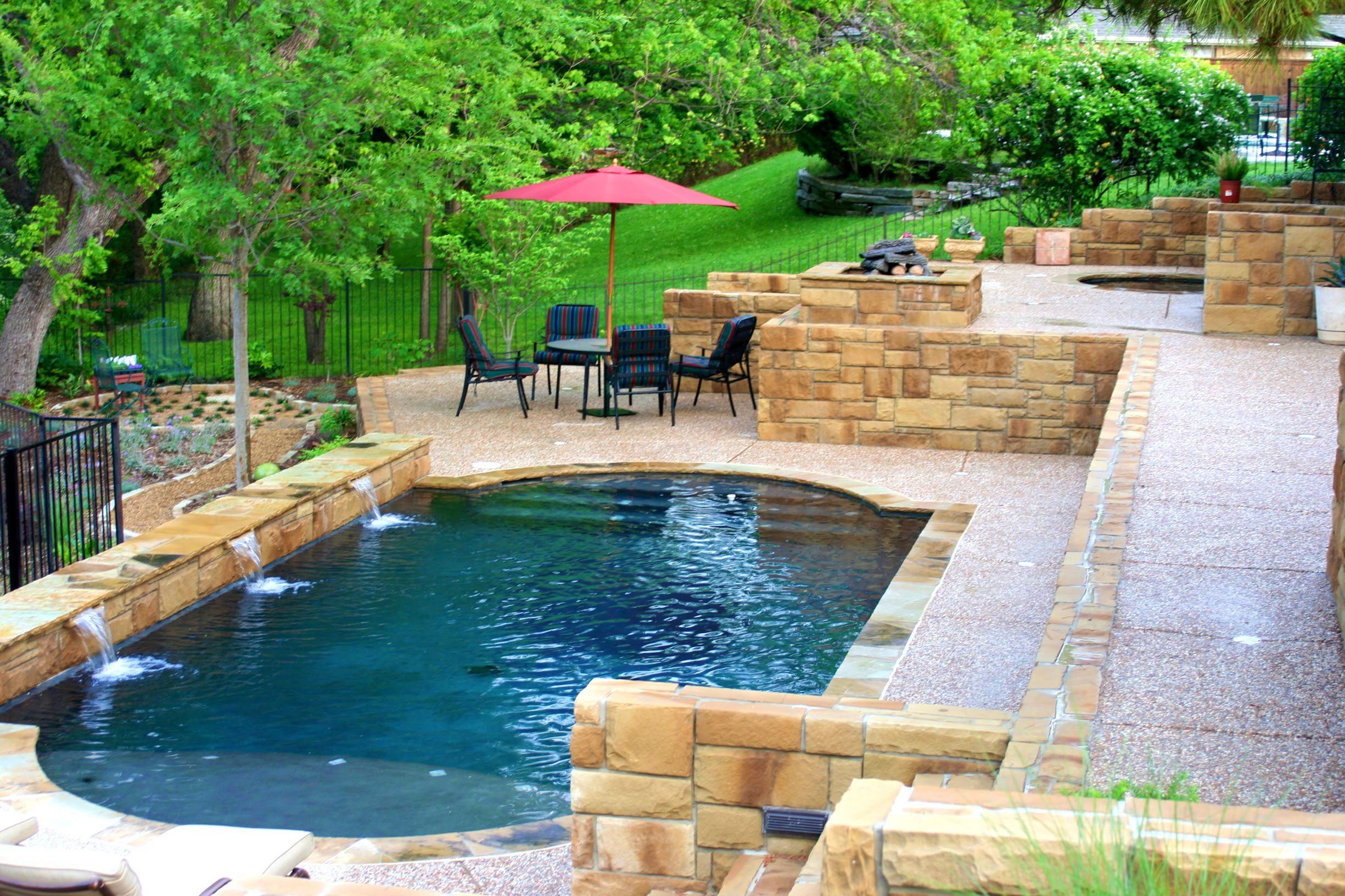 Custom built rectangle swimming pool with flagstone deck and blue ...