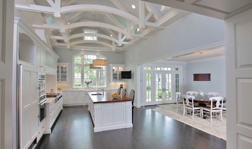 White Kitchen Vaulted Ceiling this massive, vaulted ceiling kitchen design is open, spilling