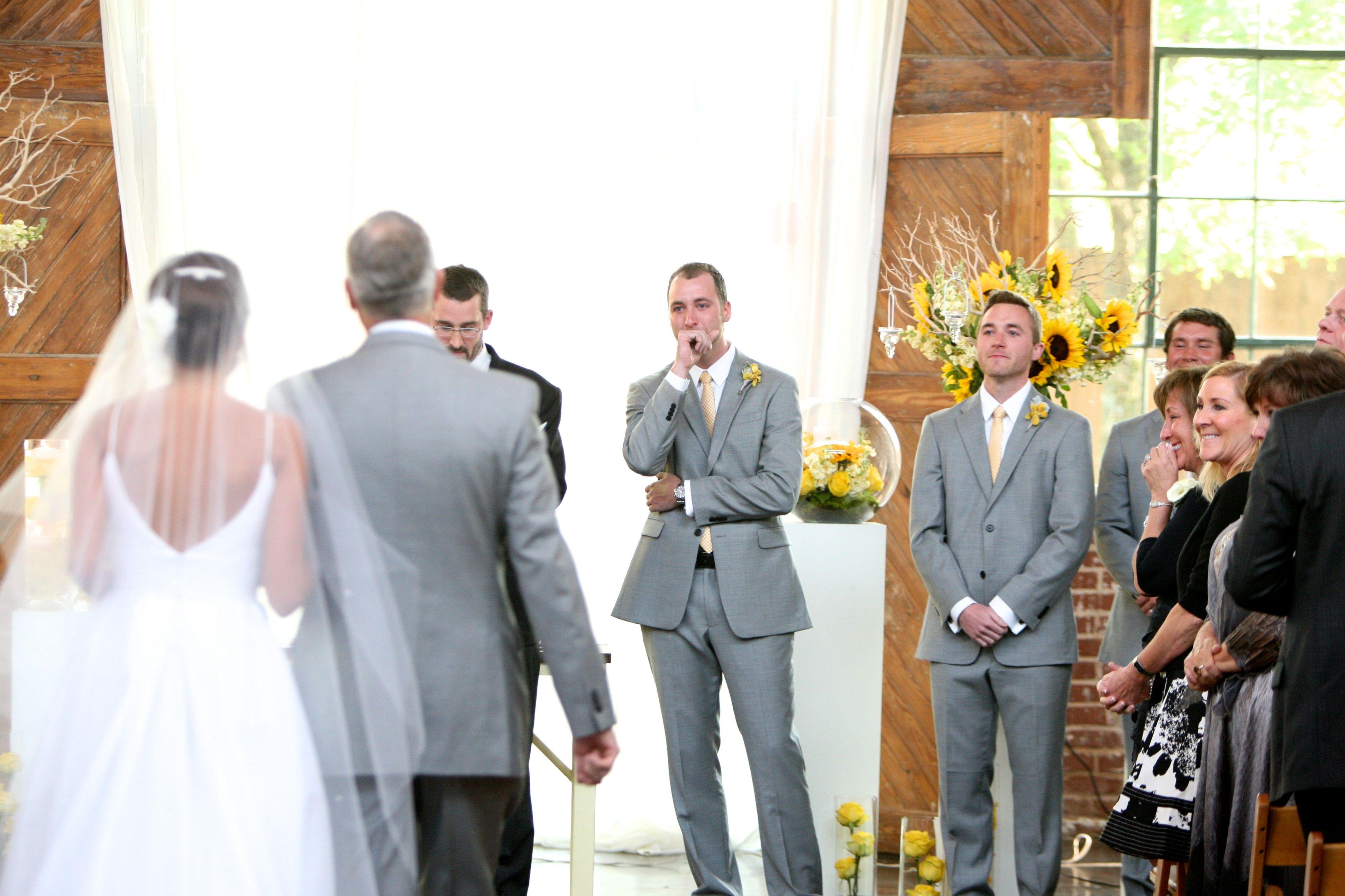 Groom reaction, wedding, walking down the aisle, groom crying