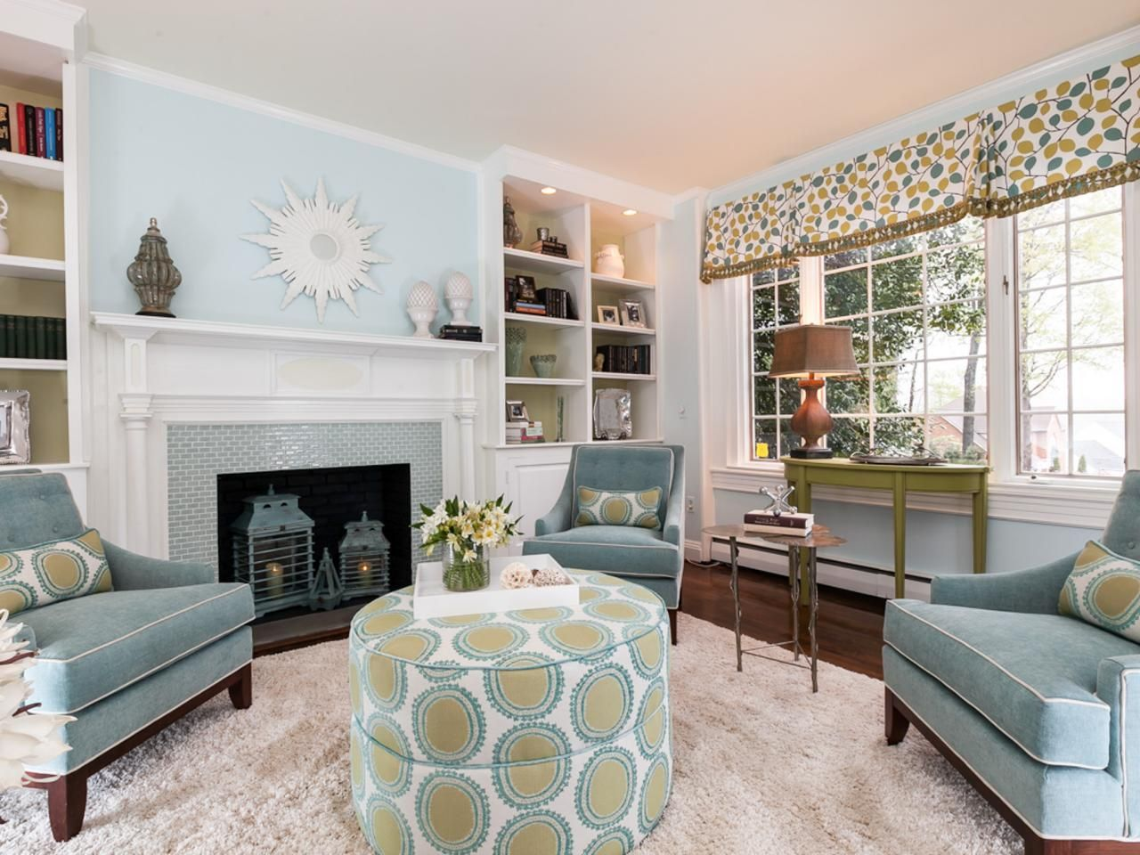 Visit HGTV To See More Of This Light Blue Transitional Living Room With Tiled Fireplace Surround