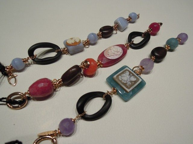silver bracelet with ebano items and stones.
