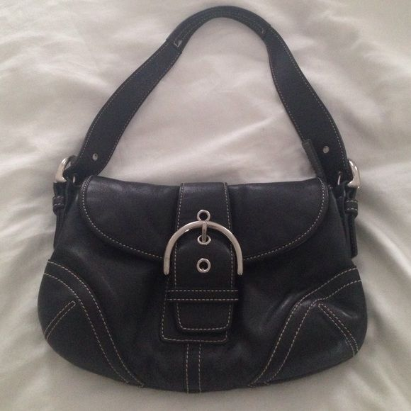 Coach black leather shoulder bag Beautiful leather Coach shoulder bag with two main compartments and three smaller pockets. Gently worn, leather in excellent condition. Coach Bags Shoulder Bags