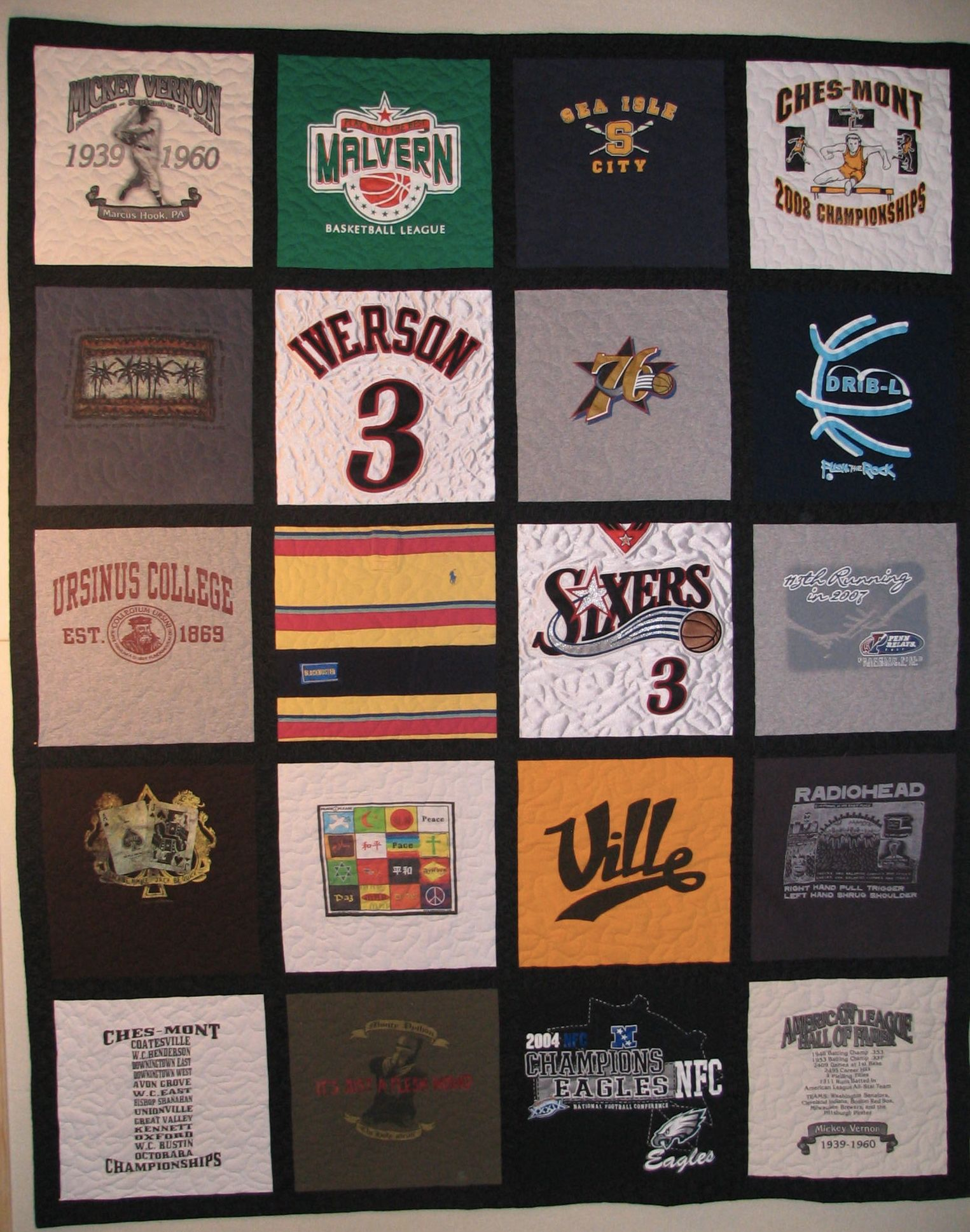 T-Shirt quilt with sashing between the blocks - includes a few jersey type shirts.