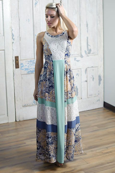 Beautifully elegant lace and floral maxi dress with colorblock accents.