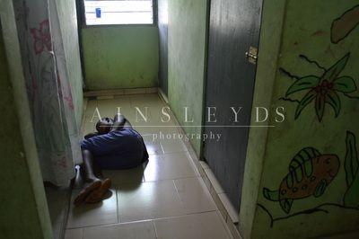 A girl sleeps in a Ghanian orphanage.