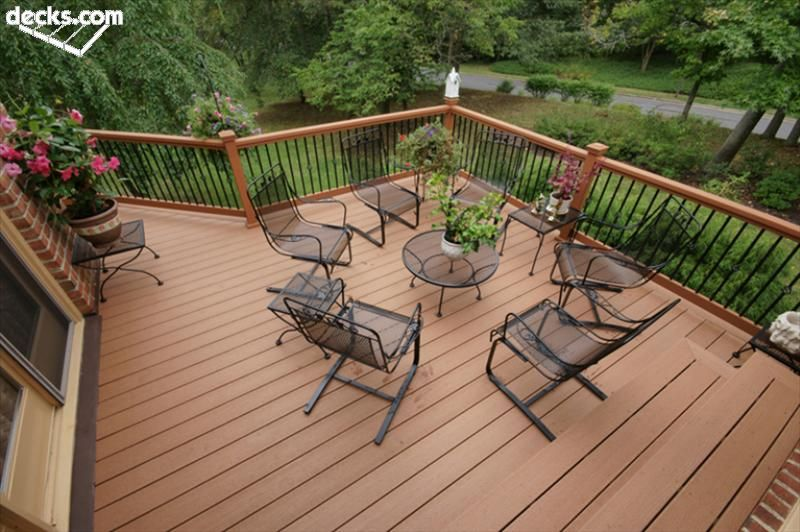 Iron deck railing ideas railing balusters our sponsor for Garden decking banister