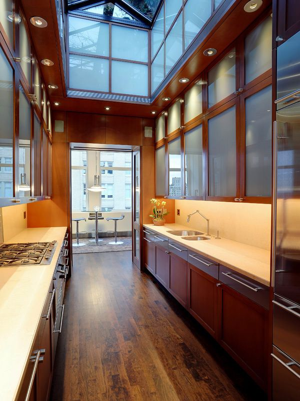 This Cherry Wood And Limestone Galley Kitchen Is Made To Feel Expansive By An Amazing Skylight New York Penthouse New York Loft Penthouse For Sale